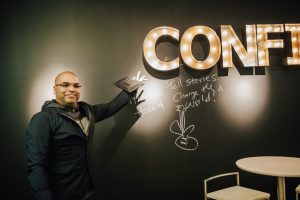"Hosein signs our ""Confidence"" wall"
