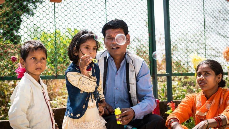 Children burn bubbles outside the Dehradun clinic.