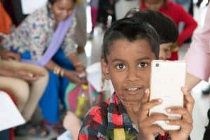 A young boy with burns takes a selfie while waiting to see the doctor.